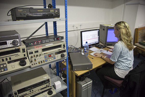 Grace Coates of Doxa Productions works on digitising video tapes from the ANC Archives. Doxa worked two shifts for a number of months to complete the project in time. PHOTO: David Larsen / Africa Media Online