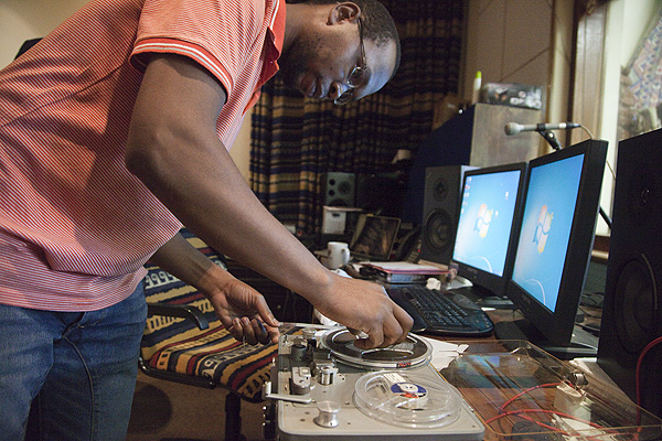 Elijah Madiba of the International Library of African Music (ILAM) works on tape reels from the ANC Archive. PHOTO: David Larsen / Africa Media Online