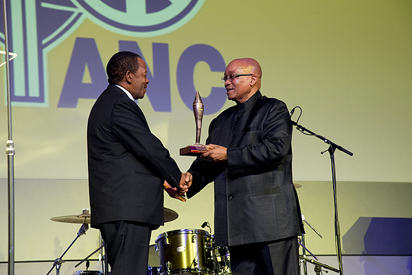 President Zuma hands a statuette of the ANC Flame of Freedom to Mr Nolo Letele as an expression of gratitude for their role in funding the digitisation of the ANC Archives.