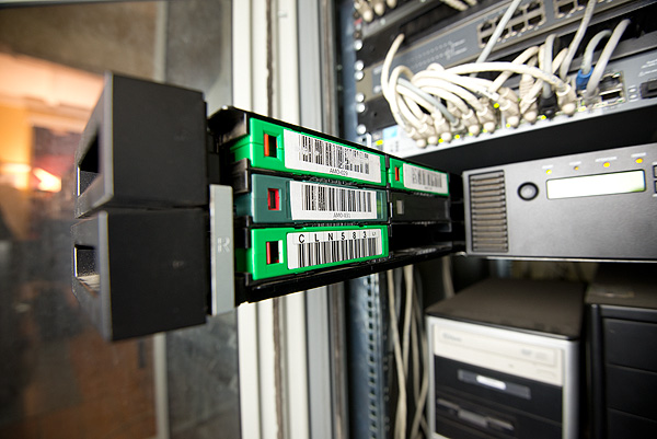 An LTO tape backup system. Such tape systems that allow for offsite storage of backups are best practice for the backup of digital content stored on servers. They are a fundamental part of an archival digital repository system.
