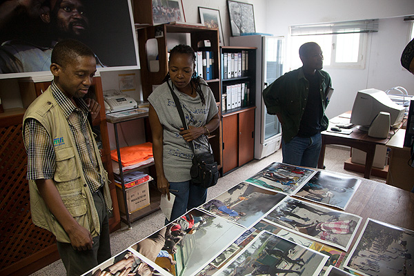 Members of the Associação Moçambicana de Fotografia in Maputo Mozambique make a selection of photographs for an exhibition on election violence to coincide with the display of the World Press Photo Exhibition in the city. Quality curation always involves a determined and ruthless selection process. In a context like this, where many are involved in the selection process, it can create vigorous debate.