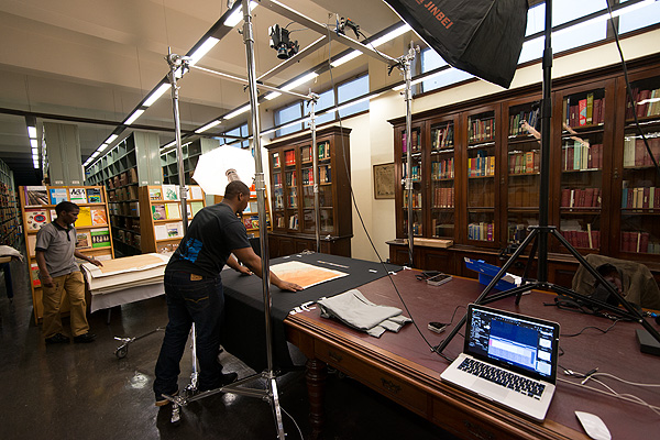 The AMO team working on digitising maps and posters at the KwaZulu-Natal Museum. The Phase One XF can be seen at the top of the picture suspended above Nkanyiso Ngcobo's head.