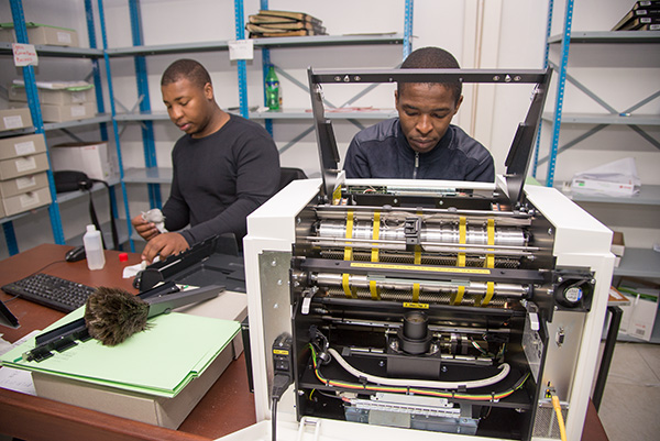 Africa Media Online team members, Nkanyiso Ngcobo and Francis Ntsikithi work as a team on the Inotec Scamax machine. The machine operates differently to the standard form feed scanners. It is belt driven, which makes it very gentle on aged paper