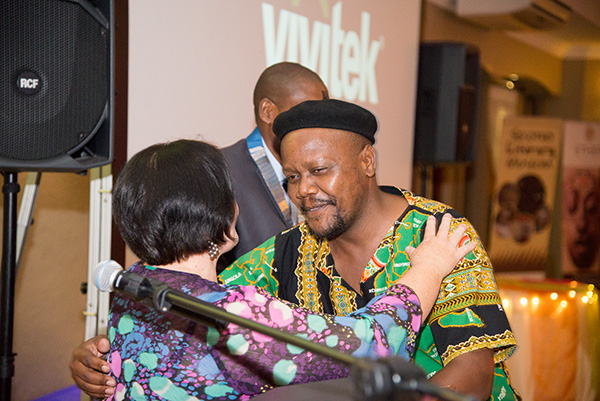 "Bonginkosi ""Rock"" Zuma receiving an award at the SAMA Conference banquet from Riana Mulder."