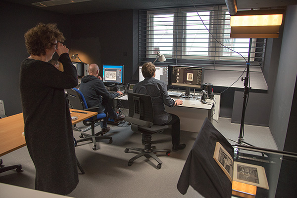 Cecile van der Harten Head of the Image Department at the Rijksmuseum (left) in one of the studios with Staff Photographer Henni van Beek demonstrating the capture of a rare manuscript