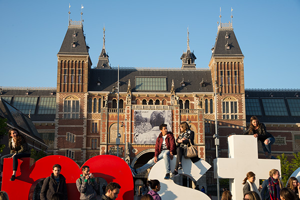 "Spring in Amsterdam. Crowds gather around the ""I Am Amsterdam"" monument outside the Rijksmuseum."