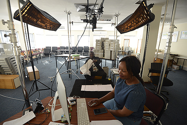 Sne Mkhize and Olu Bamigboye operate our Phase One XF camera with Phase One 100 Megapixel digital back. This setup, with Broncolor lights was first used to capture photographic prints at 600 ppi and then we moved on to assisting in the capture of fragile manuscripts.