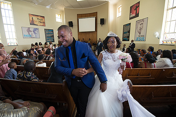 "Nkanyiso Ngcobo takes hold of his wife, Sanelisiwe Ngcobo (nee Nxumalo) at their ""white"" wedding ceremony."