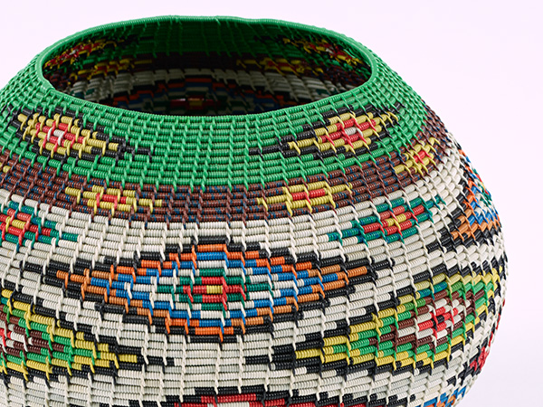 Detail of an object digitally captured by Africa Media Online showing the depth of focus along the side of the object achieved by focus stacking. File Name: PHM_20161018_20308.tif, Item: Unlidded telephone wire basket, Provenance: Inanda.