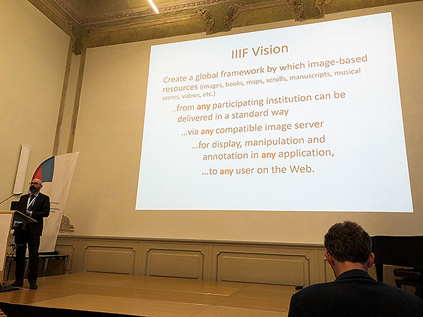 Josh Hadro, Managing Director of IIIF, presenting the vision of IIIF at the IIIF 2019 international conference in Göttingen, Germany. The vision represents significant interoperability for digital collections between institutions all over the World.